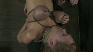 Hanging upside down Rain DeGrey gets her boobs tied up
