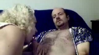 Curly blond head does her best while sucking a dick for sperm