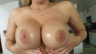 Buxom blonde trollop Rachel Solari shows off her assets